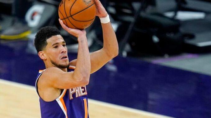 AP - Phoenix Suns guard Devin Booker (1) shoots over Chicago Bulls forward Patrick Williams (44)