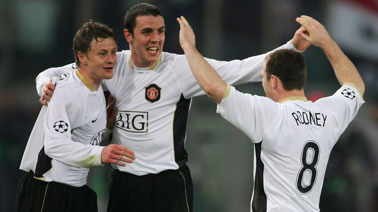 Ole Gunnar Solskjaer and John O'Shea celebrate with Wayne Rooney after his equaliser against Roma in the Stadio Olimpico