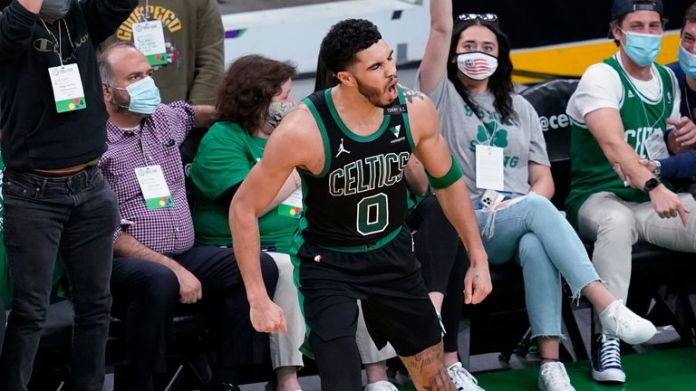 Boston Celtics forward Jayson Tatum celebrates his made basket with fans in Game 3 against the Brooklyn Nets during an NBA basketball first-round playoff series
