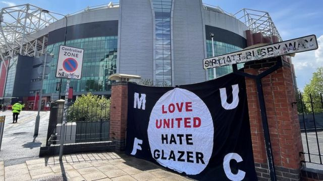 A banner is placed outside Old Trafford in protest at the club's owners, The Glazers