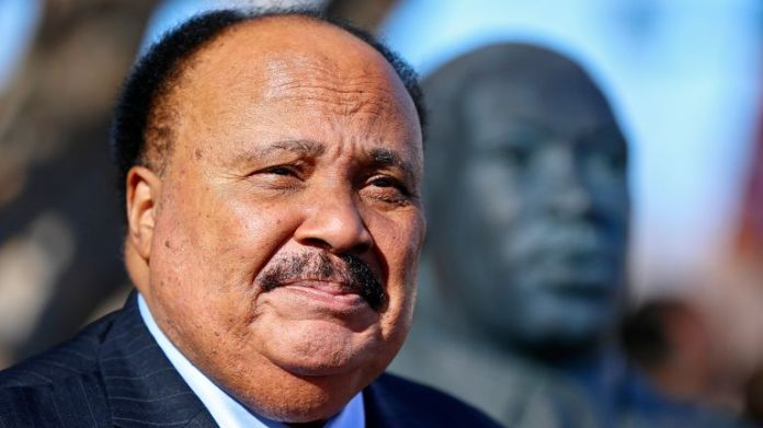 Martin Luther King III stands next to a bust of his father, the Rev. Martin Luther King Jr., during a wreath laying ceremony in 2018 (Pic: The Topeka Capital-Journal via AP)