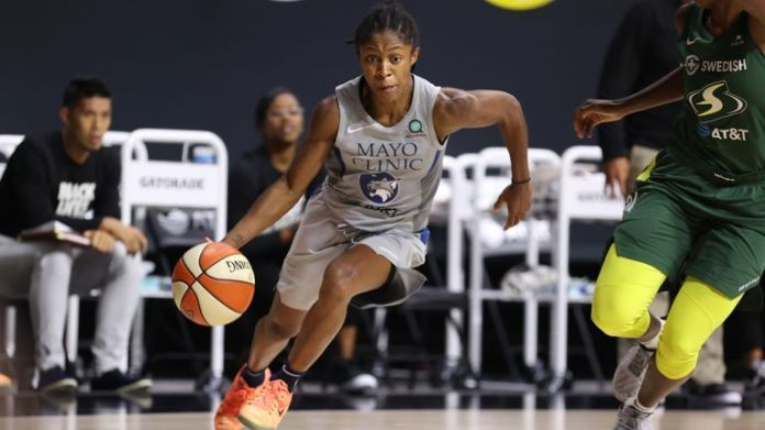 Crystal Dangerfield of the Minnesota Lynx drives to the basket against the Seattle Stormin Game Two in the 2020 WNBA Semi-finals