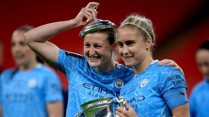 Manchester City's Ellen White (left) and Steph Houghton celebrate with the trophy after winning the Women's FA Cup Final at Wembley Stadium, London (Nov 2020)