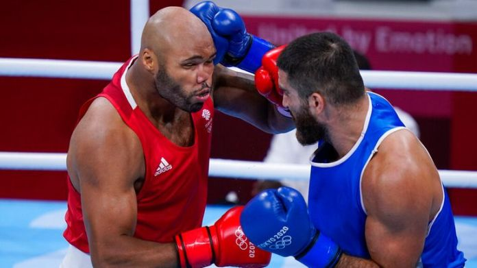 Eliad Mourad, of France, right,  punches Britain's Frazer Clarke during a men...s super heavyweight over 91-kg boxing match at the 2020 Summer Olympics, Sunday, Aug. 1, 2021, in Tokyo, Japan. (AP Photo/Frank Franklin II)