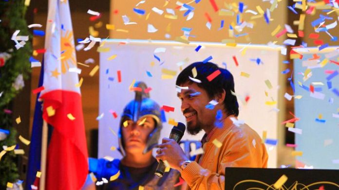 Confetti rain on Filipino boxer and Congressman Manny Pacquiao during a news conference upon arrival in Manila, Philippines early Saturday June 16, 2012 from Los Angeles. Pacquiao, who lost his WBO Welterweight title to American Timothy Bradley via a controversial split decision June 9, 2012, arrived Saturday to check the situation in his home province of Sarangani in southern Philippines following floodings that affected thousands of residents. (AP Photo/Bullit Marquez)