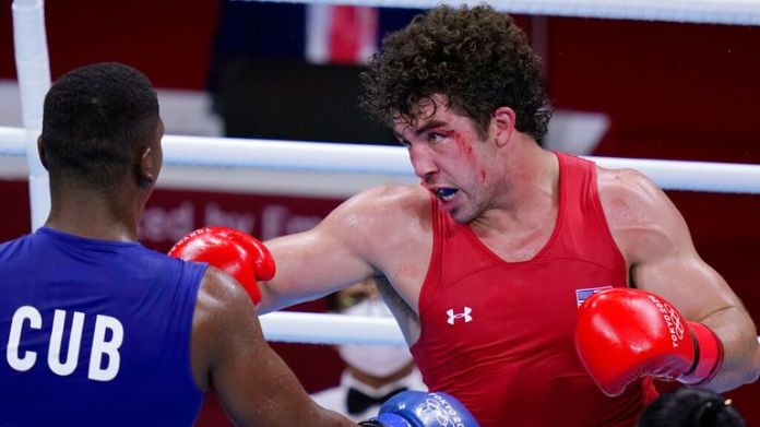 Richard Torrez Jr., from the United States, right, exchanges punches with Cuba...s Dainier Pero during their men...s super heavyweight over 91-kg boxing match at the 2020 Summer Olympics, Sunday, Aug. 1, 2021, in Tokyo, Japan. (AP Photo/Frank Franklin II)