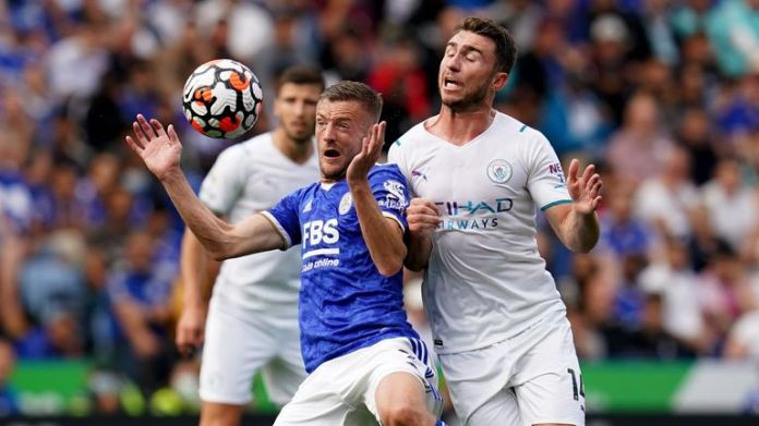 Jamie Vardy is clattered by Aymeric Laporte