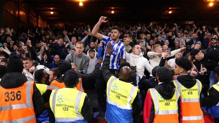 Brighton fans celebrate their dramatic draw