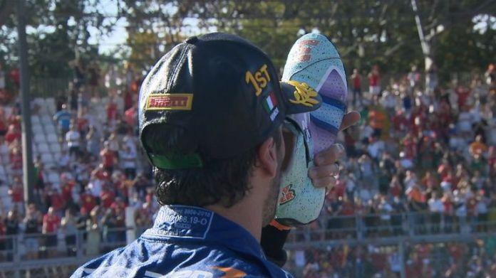 After winning the Italian Grand Prix, Ricciardo celebrates by doing his traditional 'shoey' celebration