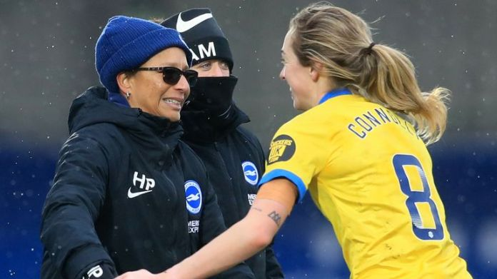 Megan Connolly celebrates with Brighton manager Hope Powell after her winning goal