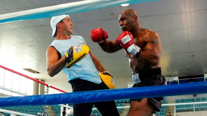 Former Heavyweight Champion Mike Tyson, right, spars with his trainer Jeff Fenech in the ring at Burr Gymnasium on the Campus of Howard University in Washington Tuesday, June 7, 2005 in preparation for Saturday's fight against Kevin McBride. (AP Photo/Pablo Martinez Monsivais)