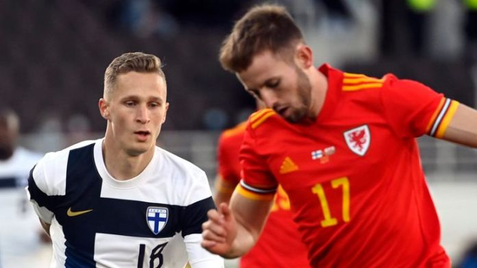 Rhys Norrington-Davies of Wales (R) and Finland's Santeri Hostikka (18) fight for the ball during the international friendly football match Finland vs Wales at the Helsinki Olympic Stadium in Helsinki, Finland, on Wednesday, 1st Sep., 2021. LEHTIKUVA / ANTTI AIMO-KOIVISTO - FINLAND OUT. NO THIRD PARTY SALES.