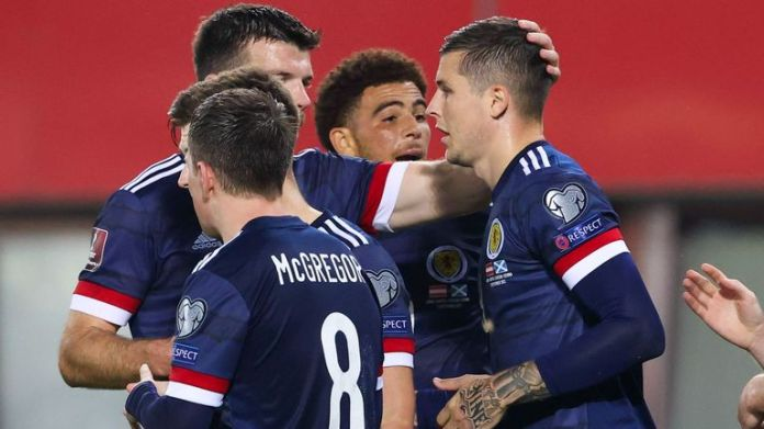 Scotland's Lyndon Dykes (R) celebrates making it 1-0 during the FIFA World cup Qualifier between Austria and Scotland at the Ernst-Happel-Stadion
