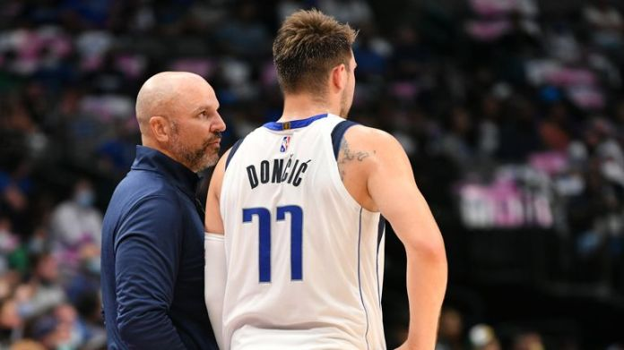 The point guard whisperer? Jason Kidd talks to Luka Doncic during a pre-season game