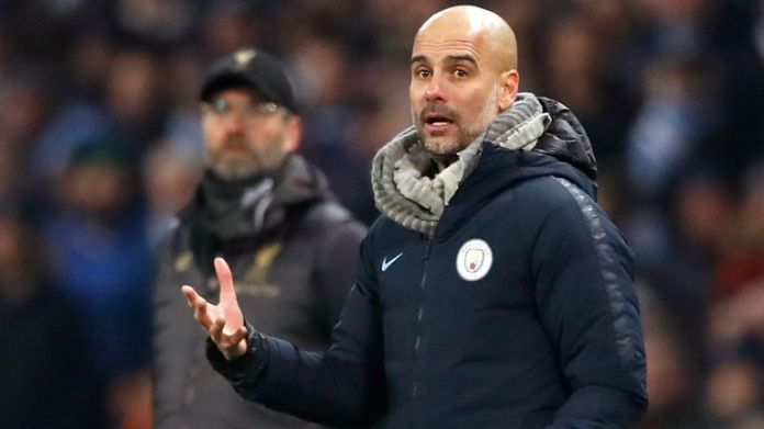 Manchester City manager Pep Guardiola (right) and Liverpool manager Jurgen Klopp during the Premier League match at the Etihad Stadium, Manchester.
