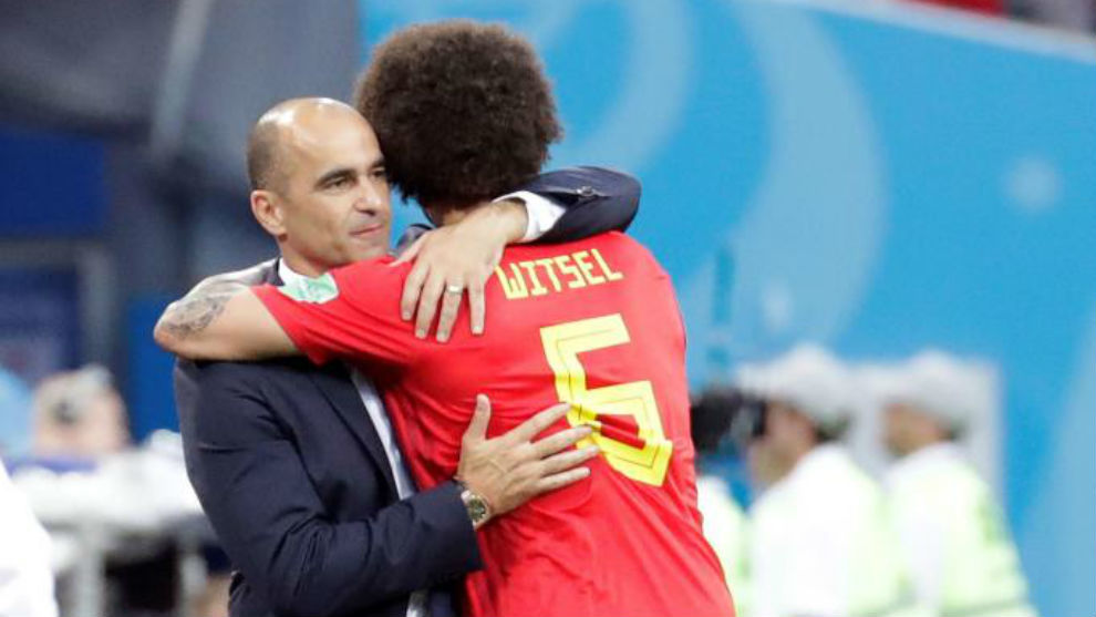 Axel Witsel hugs Roberto Martínez after being substituted.