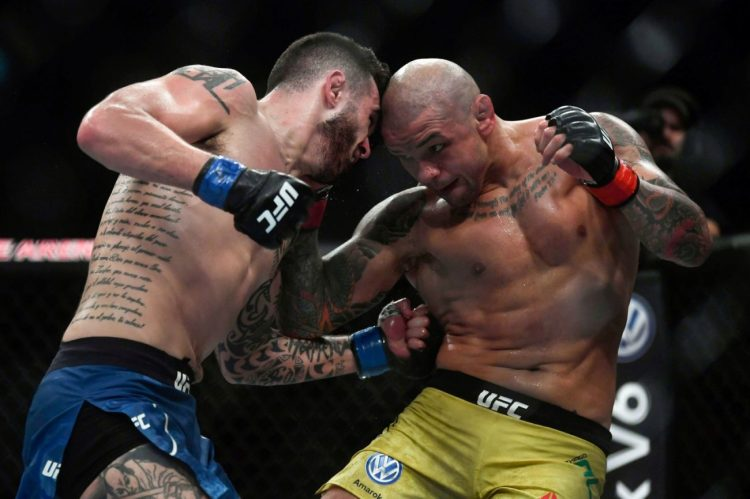 Laureano Staropoli whips a flurry of hooks into the body of Thiago Alves en route to an easy unanimous decision victory | Dolidze vs Staropoli