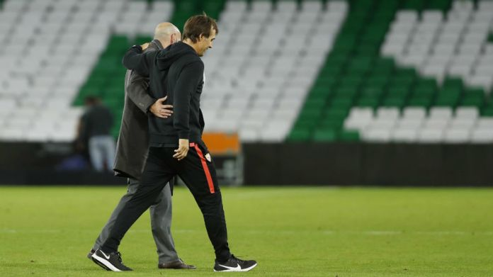 Monchi (50) and Lopetegui (53) walk embraced in Benito ...