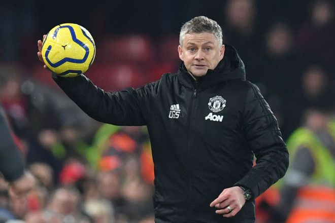Manchester Uniteds Norwegian manager Ole Gunnar <HIT>Solskjaer</HIT> throws the ball back in from the touchline during the English Premier League football match between Liverpool and Manchester United at Anfield stadium in Liverpool, north west England on January 19, 2020. (Photo by Paul ELLIS / AFP) / RESTRICTED TO EDITORIAL USE. No use with unauthorized audio, video, data, fixture lists, club/league logos or live services. Online in-match use limited to 120 images. An additional 40 images may be used in extra time. No video emulation. Social media in-match use limited to 120 images. An additional 40 images may be used in extra time. No use in betting publications, games or single club/league/player publications. /