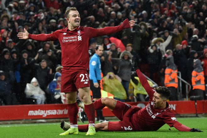 Liverpools Swiss midfielder Xherdan <HIT>Shaqiri</HIT> celebrates with Liverpools Brazilian midfielder Roberto Firmino (R) after scoring their second goal during the English Premier League football match between Liverpool and Manchester United at Anfield in Liverpool, north west England on December 16, 2018. (Photo by Paul ELLIS / AFP) / RESTRICTED TO EDITORIAL USE. No use with unauthorized audio, video, data, fixture lists, club/league logos or live services. Online in-match use limited to 120 images. An additional 40 images may be used in extra time. No video emulation. Social media in-match use limited to 120 images. An additional 40 images may be used in extra time. No use in betting publications, games or single club/league/player publications. /