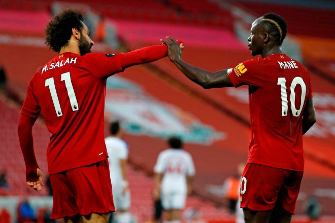 Liverpools Senegalese striker Sadio Mane (R) celebrates scoring his teams fourth lt;HIT gt;goal lt;/HIT gt; with Liverpools Egyptian midfielder Mohamed lt;HIT gt;Salah lt;/HIT gt; during the English Premier League football match between Liverpool and Crystal Palace at Anfield in Liverpool, north west England on June 24, 2020. (Photo by PHIL NOBLE / POOL / AFP) / RESTRICTED TO EDITORIAL USE. No use with unauthorized audio, video, data, fixture lists, club/league logos or live services. Online in-match use limited to 120 images. An additional 40 images may be used in extra time. No video emulation. Social media in-match use limited to 120 images. An additional 40 images may be used in extra time. No use in betting publications, games or single club/league/player publications. /
