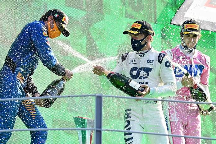 Winner AlphaTauris French driver Pierre Gasly (C) celebrates with second placed McLarens Spanish driver Carlos lt;HIT gt;Sainz lt;/HIT gt; Jr (L) and third placed Racing Points Canadian driver Lance Stroll (R) on the podium after the Italian Formula One Grand Prix at the Autodromo Nazionale circuit in Monza on September 6, 2020. (Photo by MIGUEL MEDINA / POOL / AFP)