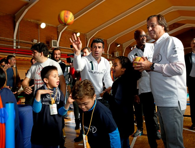 Luis Figo with Edwin Moses and Gabriel Masfurroll in an act of the Fundaci
