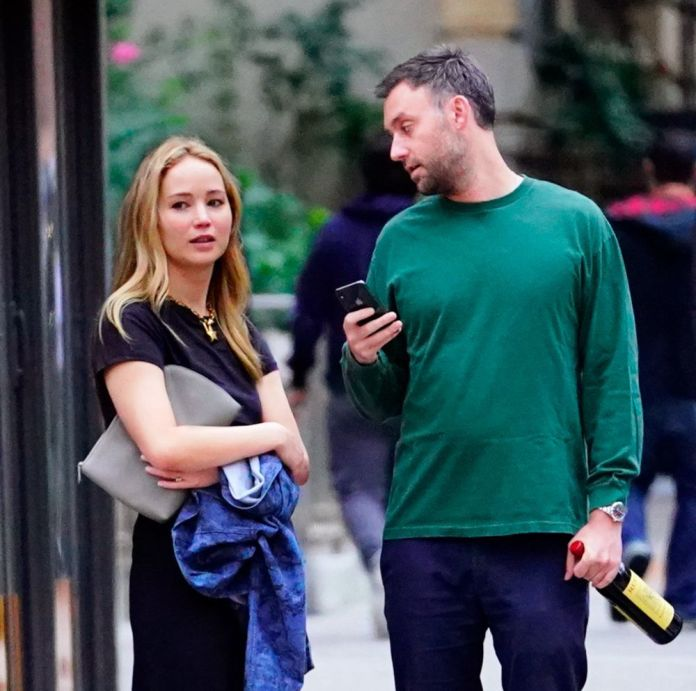 Jennifer Lawrence without makeup next to Cooke Maroney in New York.