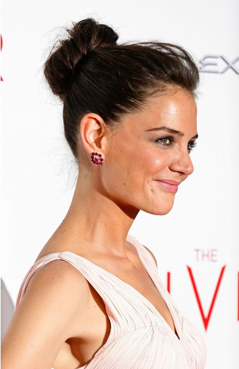 Katie Holmes with a high relaxed textured bun.