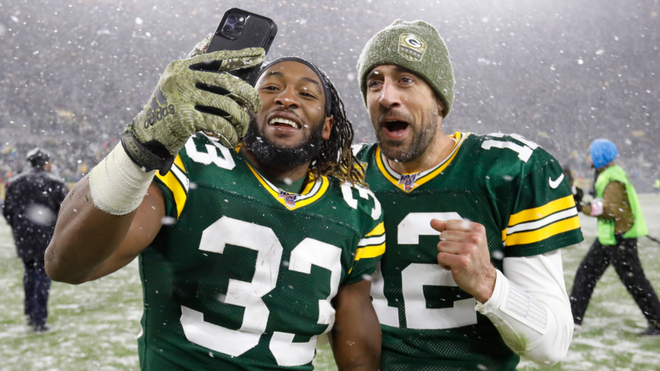 Aaron Jones and Rodgers after the game at home.