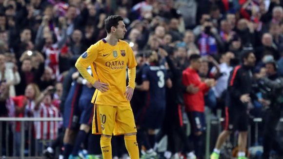 Lionel Messi stands dejected after Atletico's second goal of the night