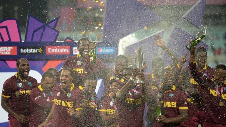 Sammy (middle) holds the trophy after winning the World T20 final against England