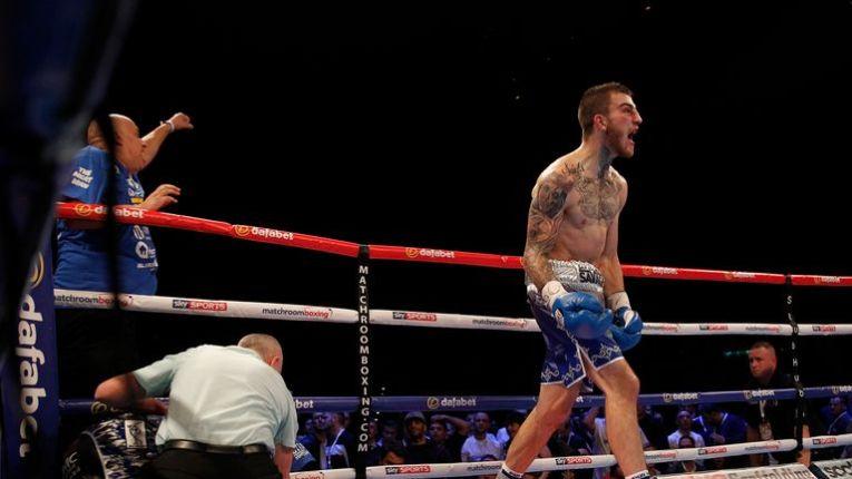 Sam Eggington celebrates after the referee calls a halt to proceedings