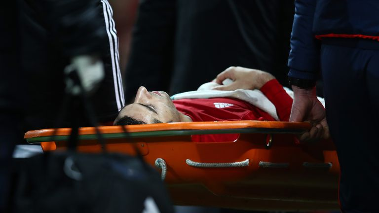 Henrikh Mkhitaryan was stretchered off in the final minutes of the game