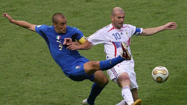 Cannavaro tussling for the ball with Zinedine Zidane during the 2006 World Cup final between Italy and France
