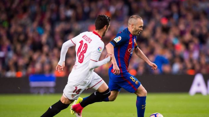 Andres Iniesta (right) and Sergio Escudero tussle for the ball