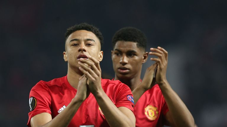 Jesse Lingard and Marcus Rashford clap the Old Trafford crowd
