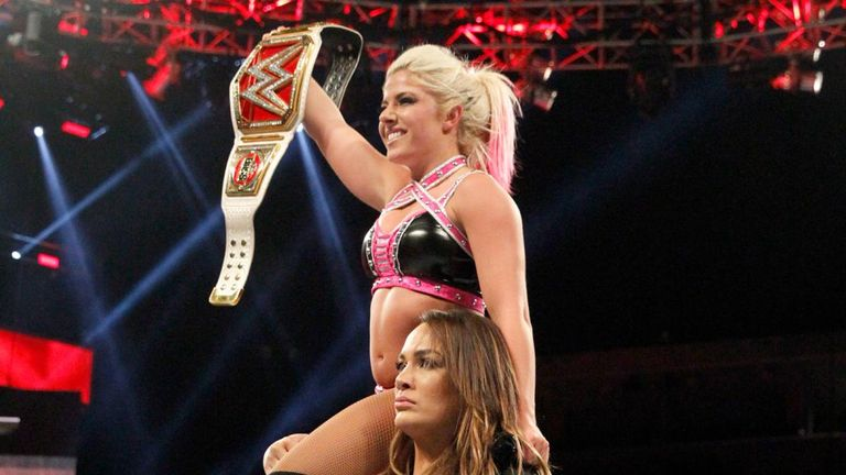 Nia Jax hoisted Alexa Bliss up high to celebrate her victory before slamming her into the mat