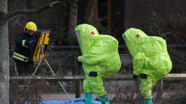 Security officers in Hazmat suits after searching a shopping centre in Salisbury