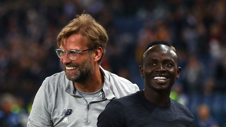 Liverpool manager Jurgen Klopp celebrates with Sadio Mane