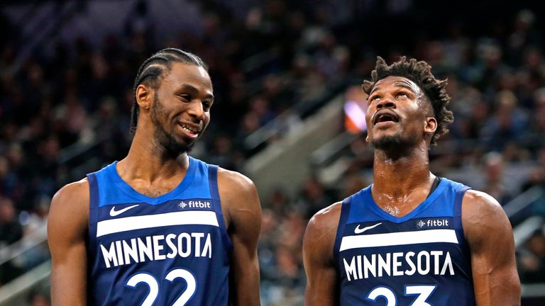 Andrew Wiggins and Jimmy Buttler talk after a foul called against the San Antonio Spurs