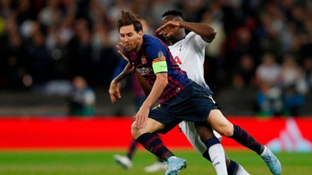 Lionel Messi gets the better of Victor Wanyama