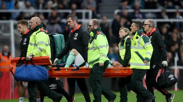 Bournemouth left-back Adam Smith was stretchered off after receiving treatment for eight minutes