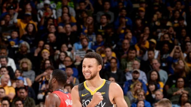 Stephen Curry celebrates as he leads the Golden State Warriors to a sixth straight win