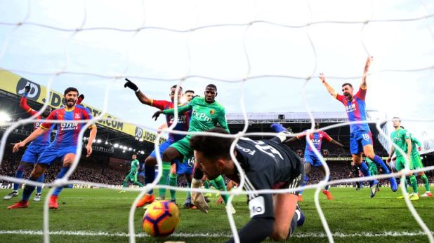 Ben Foster attempts to clear the ball as Crystal Palace score the first goal of the game