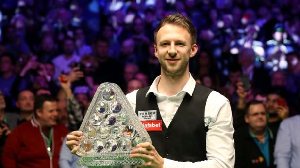 Judd Trump celebrates his Masters success at Alexandra Palace