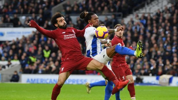 Mohamed Salah and Gaetan Bong battle for possession