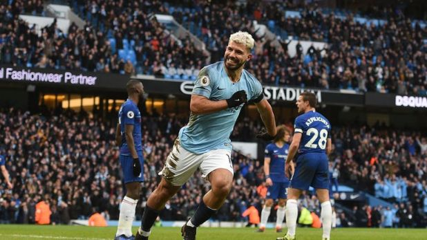 Sergio Aguero celebrates scoring Manchester City's third goal against Chelsea