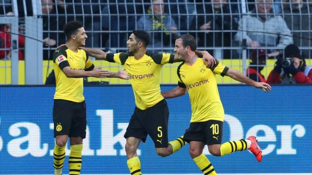 Sancho, left, celebrates scoring against Hoffenheim on Saturday