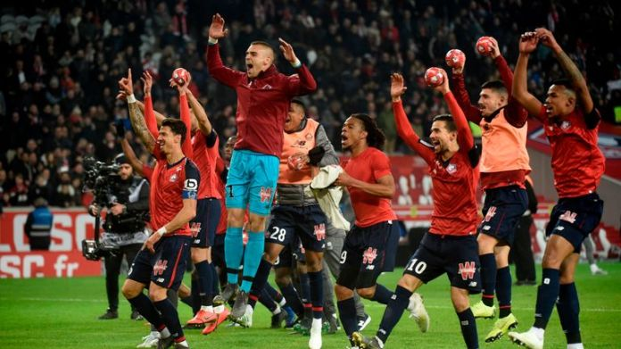 Lille players celebrate their 5-1 win over PSG